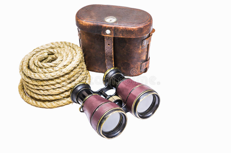 Antique binoculars with rope and leather case isolated on white royalty free stock photography