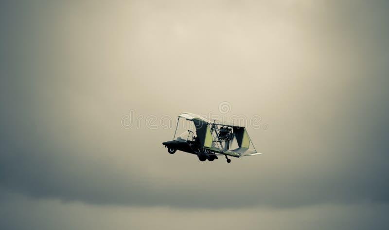 Antique biplane. Flies / retro toned stock photography
