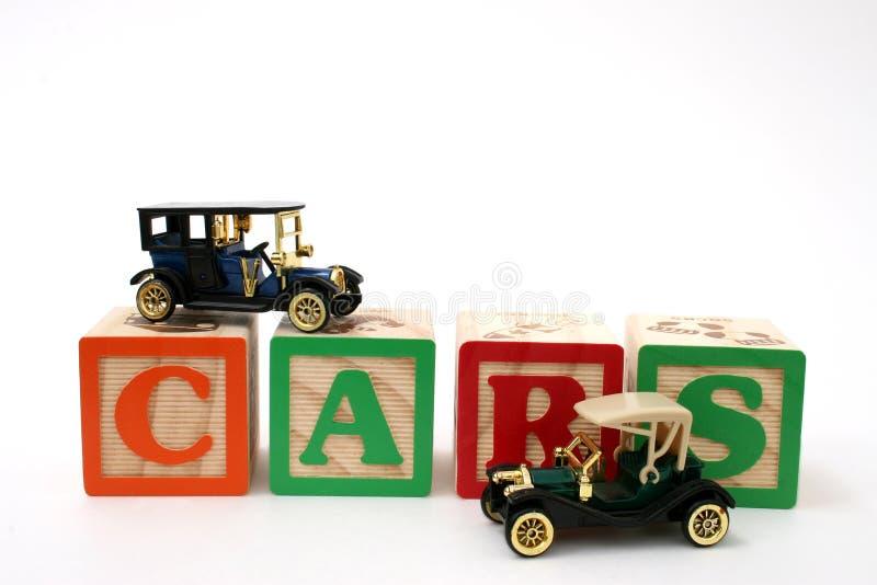 Antique Black Cars on ABC Blocks royalty free stock photography