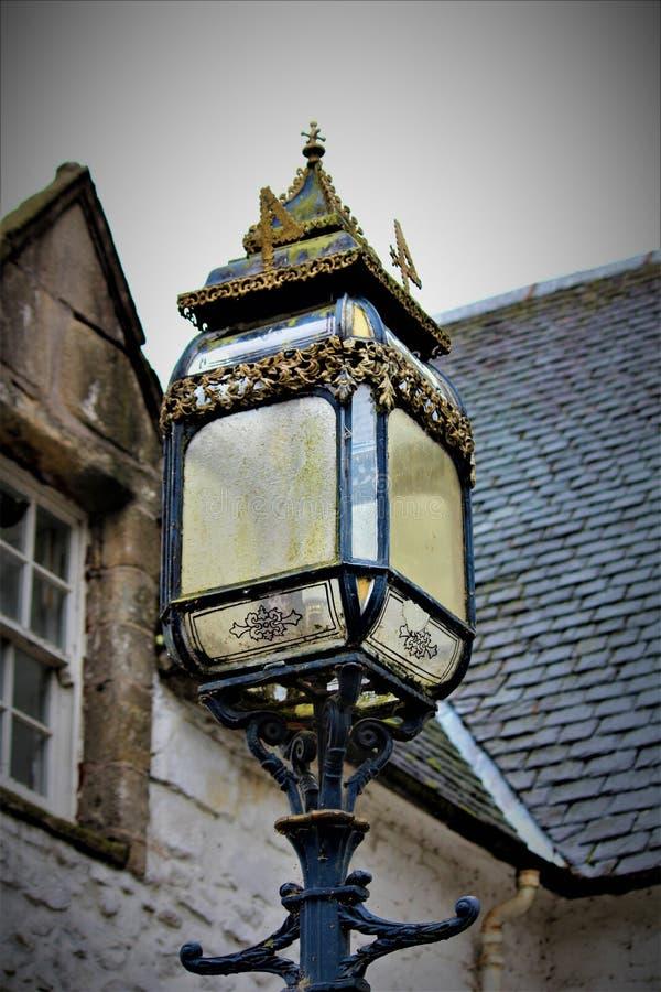 An Ornate Black Lantern. An antique black street lantern stock photo