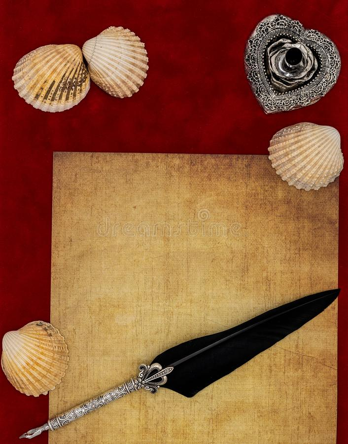 Vintage blank preachment, seashells, ornate silver quill stand ornamented quill - Love letter concept. Antique blank preachment, seashells, detailed silver quill royalty free stock image