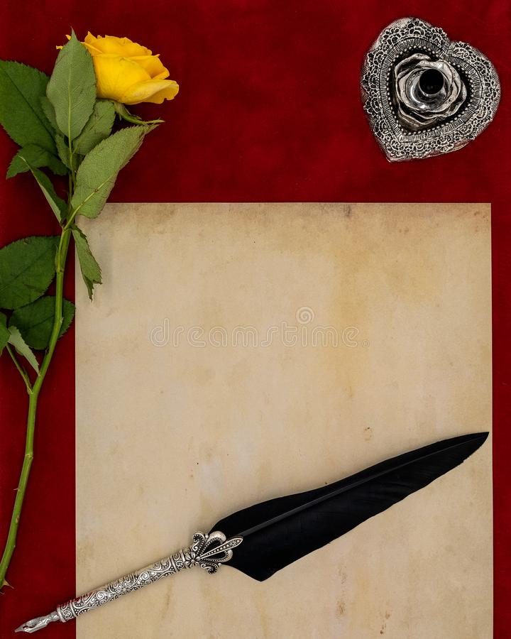 Vintage blank preachment, yellow rose, ornate silver quill stand and ornamented quill - Love letter concept. Antique blank preachment with yellow rose, detailed royalty free stock photos
