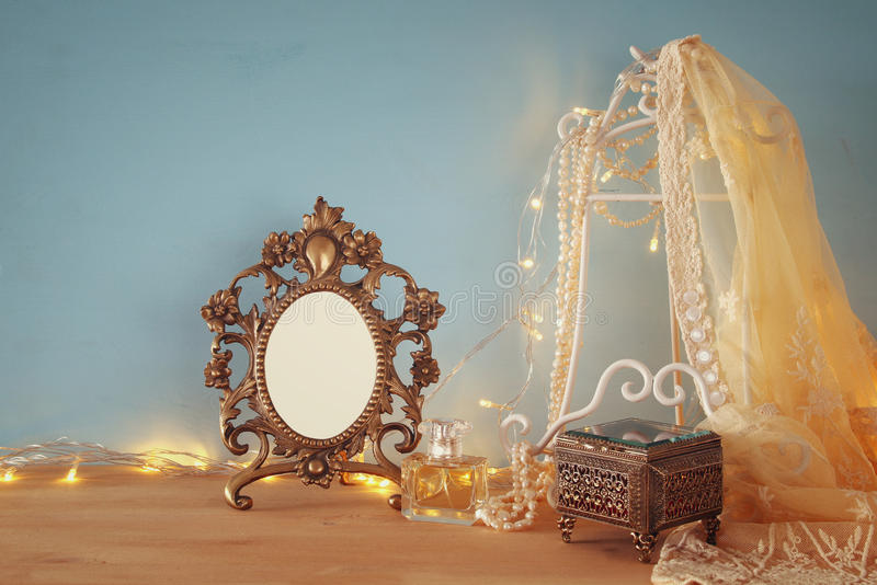 Antique blank victorian style frame on wooden table royalty free stock photography