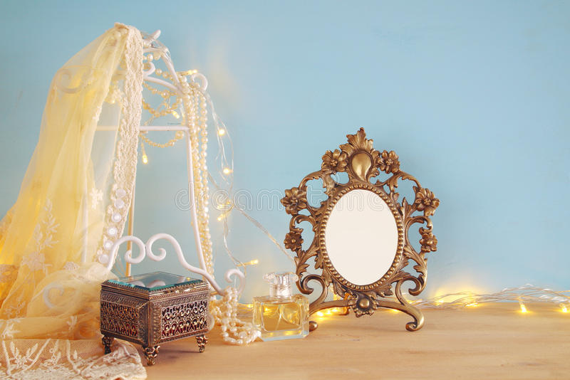 Antique blank victorian style frame on wooden table. ready to put photography. Antique blank victorian style frame on wooden table. ready to put photography stock photography