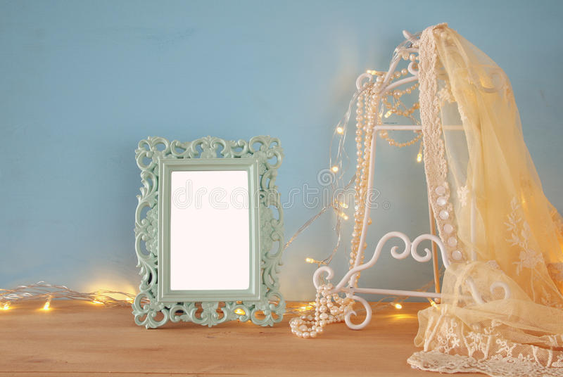 Antique blank victorian style frame on wooden table royalty free stock images