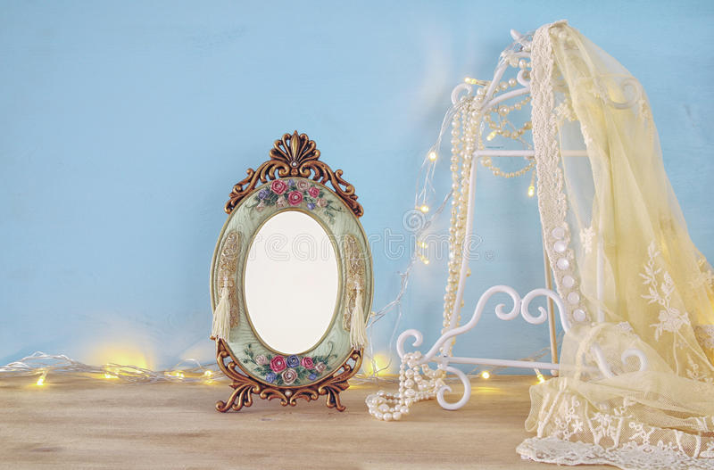 Antique blank victorian style frame on wooden table. Ready to put photography stock photo