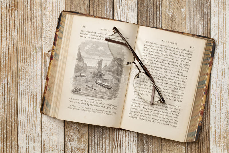 Antique book on a grunge table royalty free stock photos