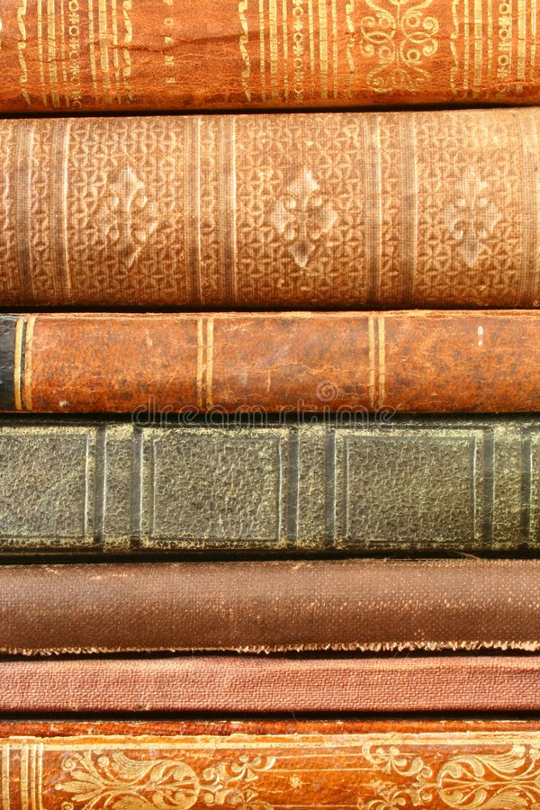 Antique Books. The Spines of a Stack of Antique Books Fill the Frame royalty free stock photo