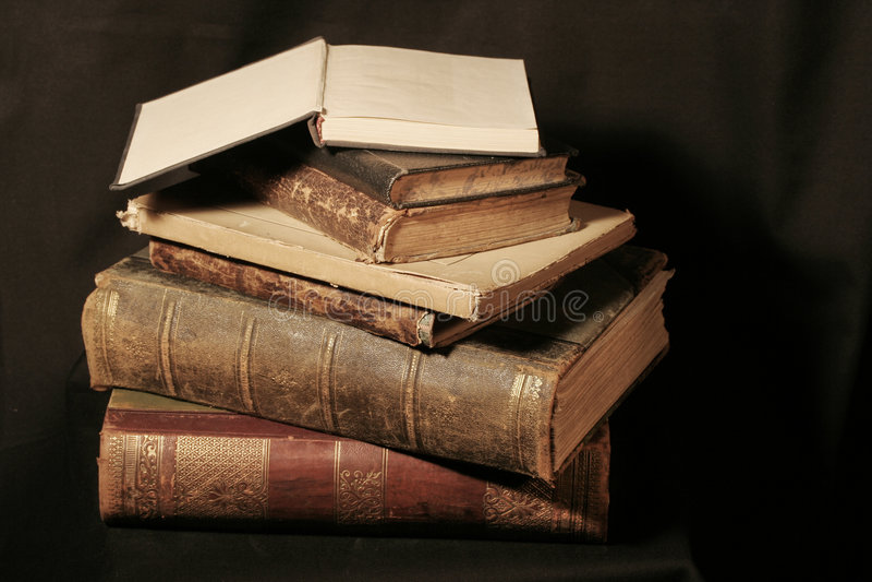Antique books on black stock images