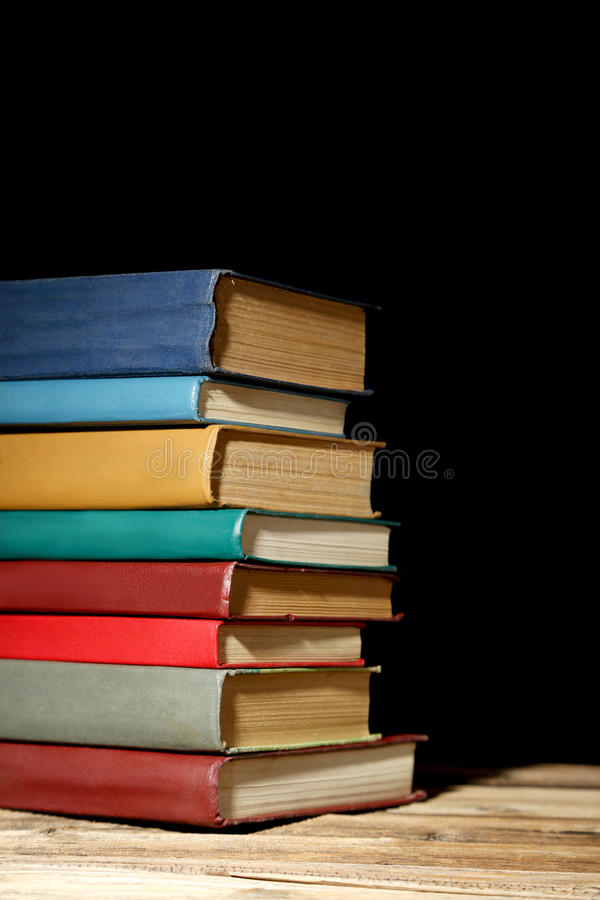 Antique books. Old antique books on brown wooden table stock image