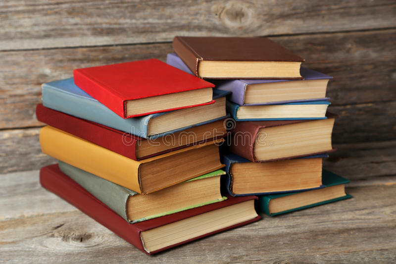 Antique books. Old antique books on grey wooden table royalty free stock photo