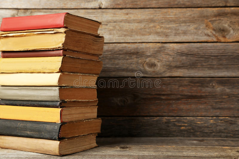 Antique books. Old antique books on grey wooden table stock photos