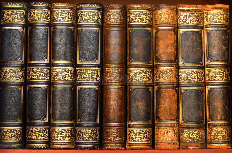 Antique books in old library. Antique books in the old library stock image