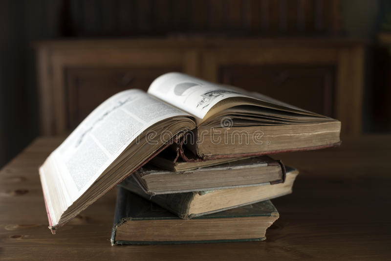 Antique books. Pile of old books in natural light royalty free stock photography