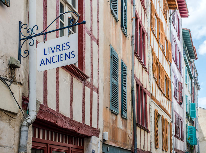 Antique books signboard in a facade of typical building of Aquitaine. royalty free stock images