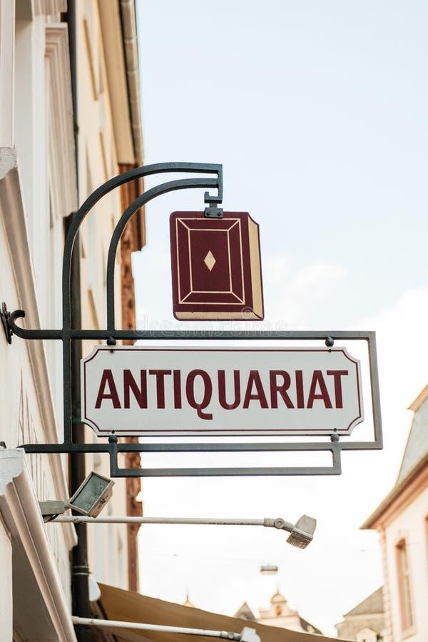 Antique bookstore sign - antiquariat stock photos