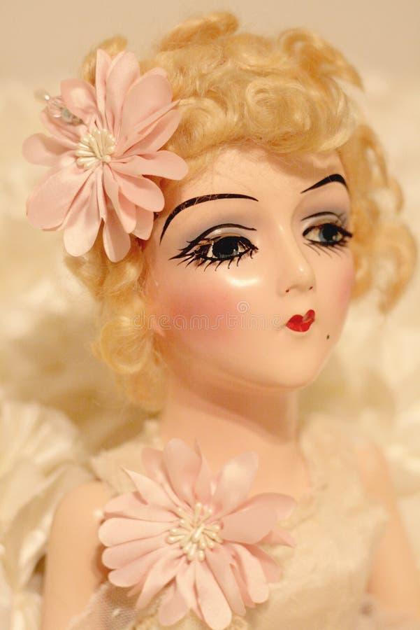 Antique Boudoir blonde bedroom doll stock photography