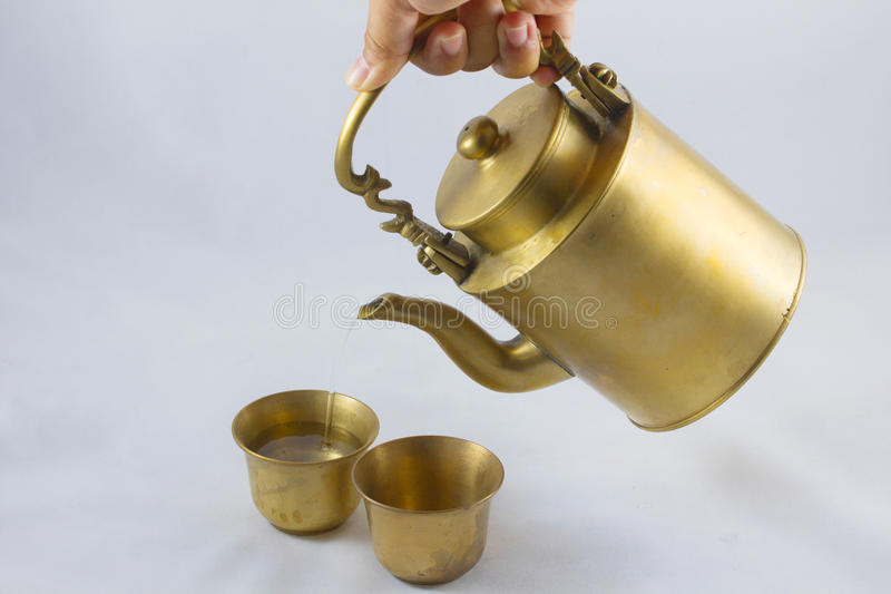 Antique brass kettle stock images