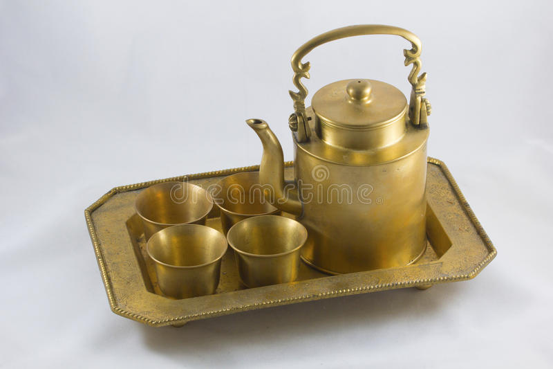 Antique brass kettle royalty free stock photography