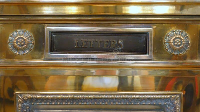 Antique Brass Mail Box stock photo
