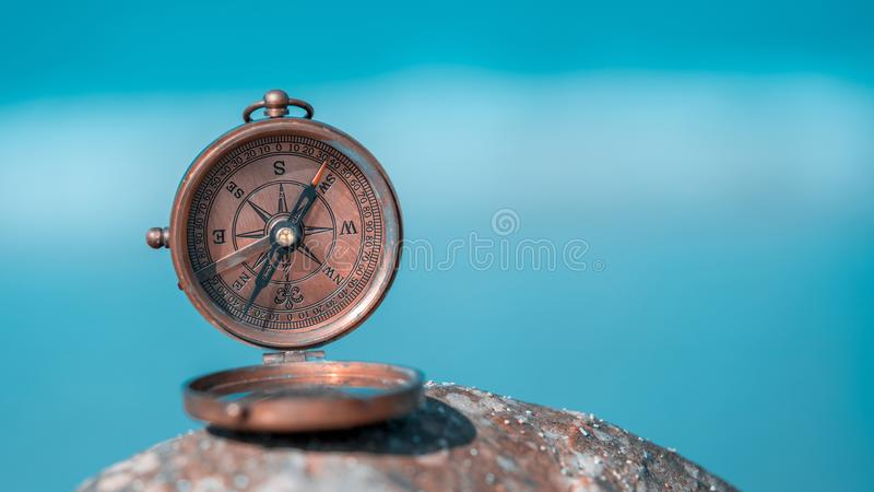Antique Brass Nautical Sundial Compass. On A Rock Stone Blurred Background royalty free stock photography