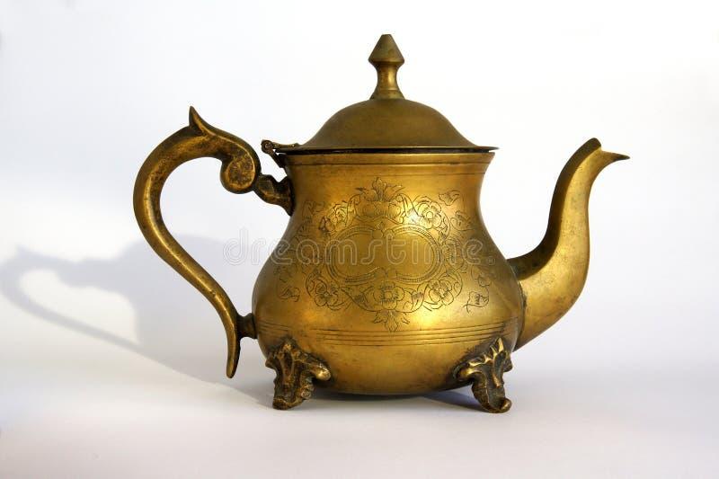 Antique brass teapot royalty free stock photo