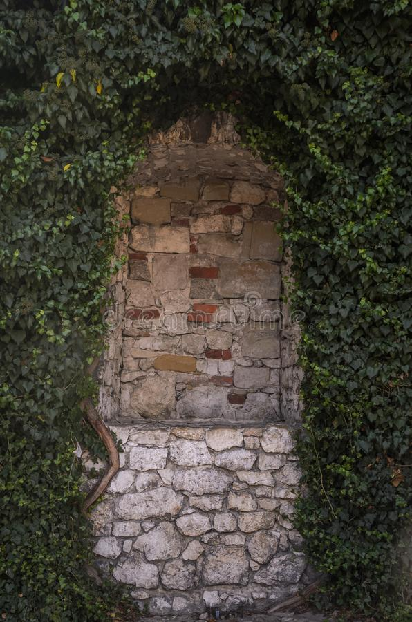 Antique brick arch in grapes.  royalty free stock images