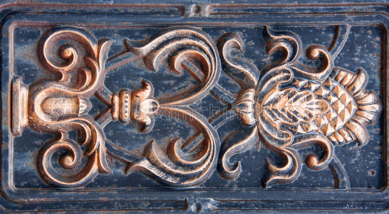 Antique bronze bas-relief of the metal as a background royalty free stock photo