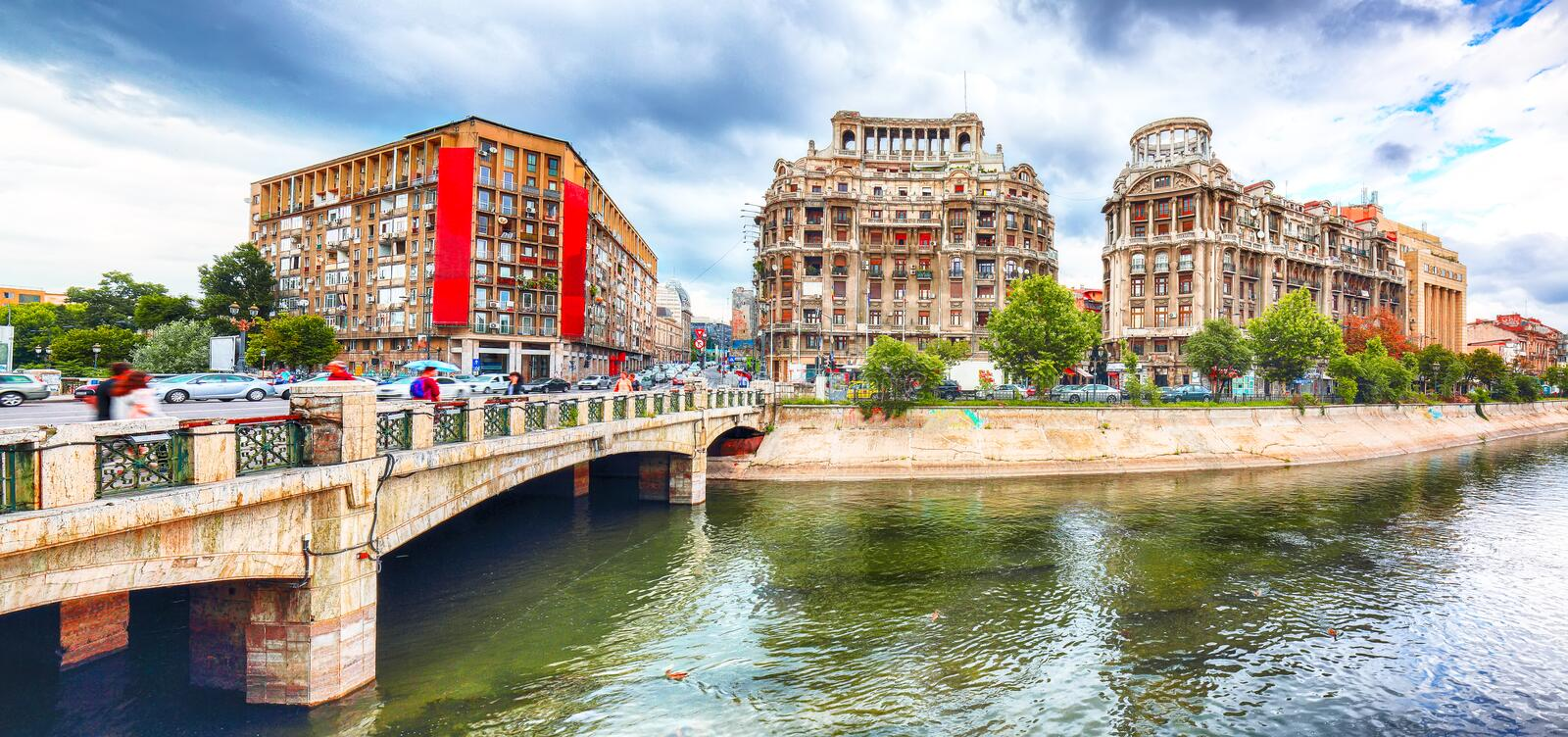 Antique building view in Old Town Bucharest city - capital of Romania and Dambrovita river royalty free stock image