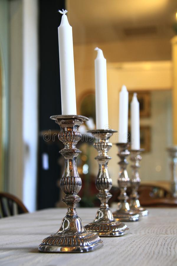 Antique candle holders stock photography