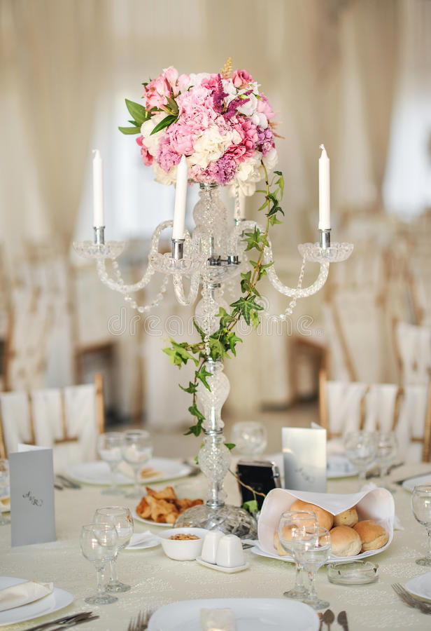 Antique candlestick with wedding bouquet. wedding candlestick with flower decoration before wedding ceremony. stock photo