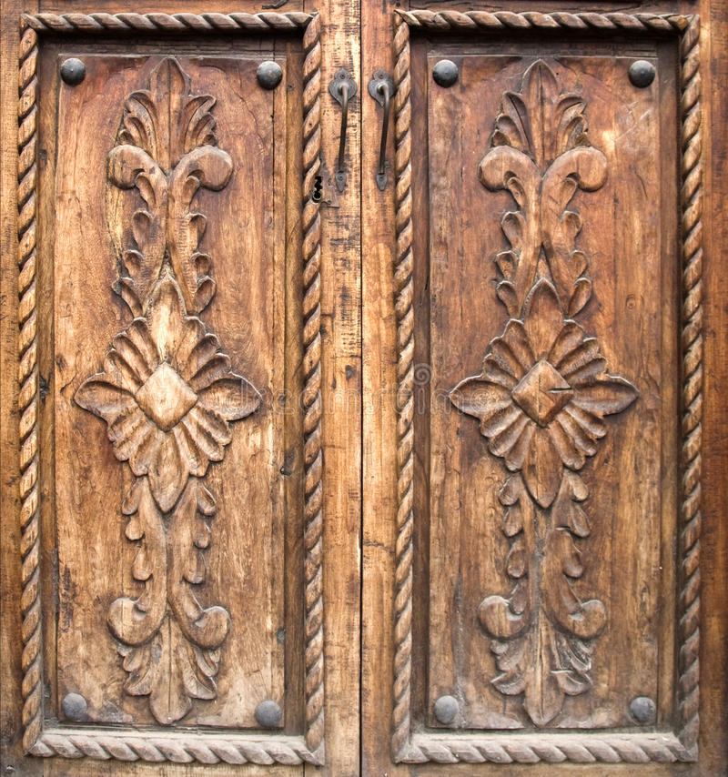 Antique carved wooden doors stock image image of keyhole for Wood carving doors hd images