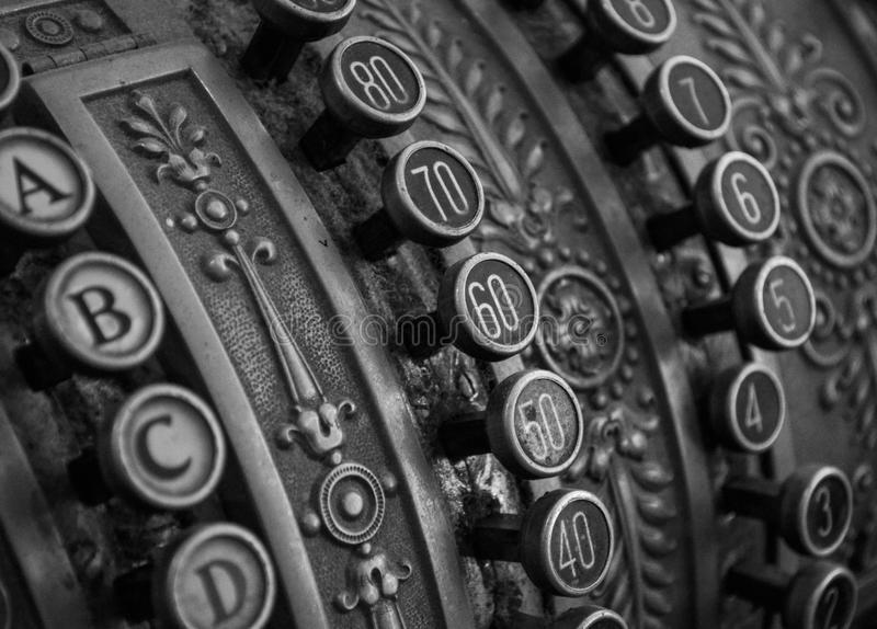Antique cash register macro shot in bw stock image