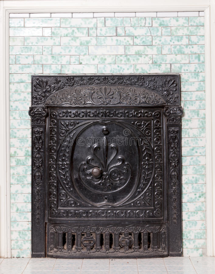 Antique Cast Iron Furnace And Tiled Wall Stock Images