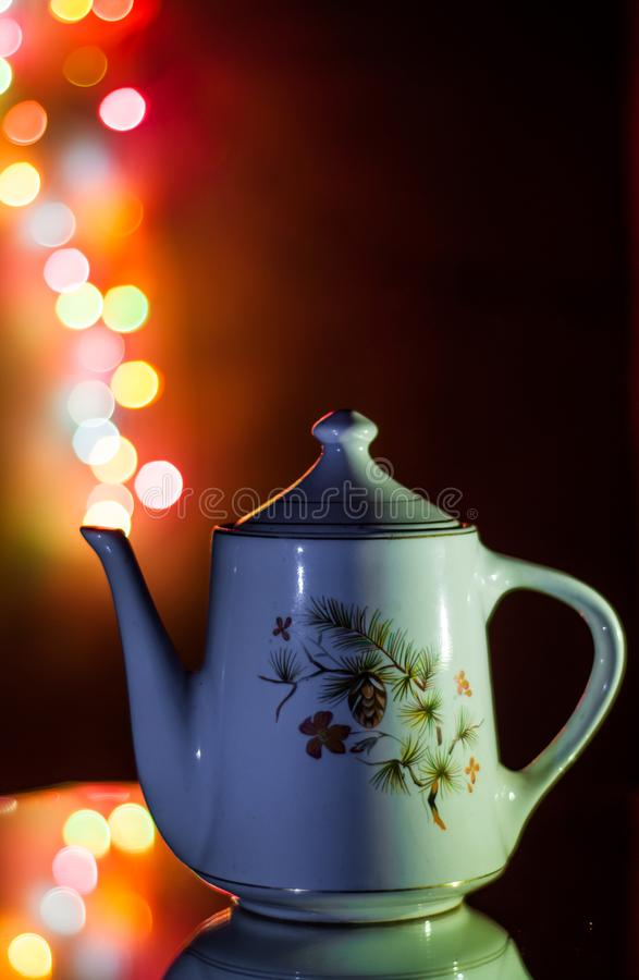 Antique Ceramic teapot with bokeh lights/ Magic lamp. Magic Lamp. Antique Ceramic teapot with bokeh lights. Creative lighting techniques were used and stock image