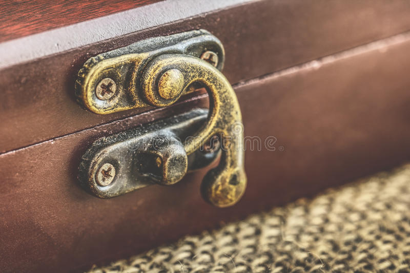 Antique chest, Closed old wooden box with metal lock stock photos