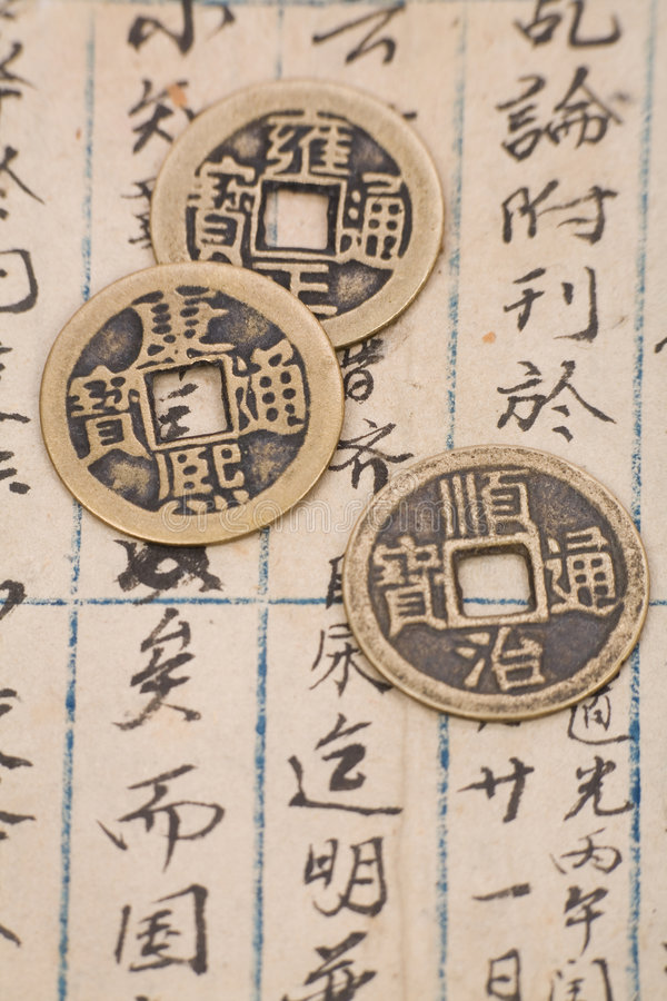 Antique chinese book page and coin. For background royalty free stock photography