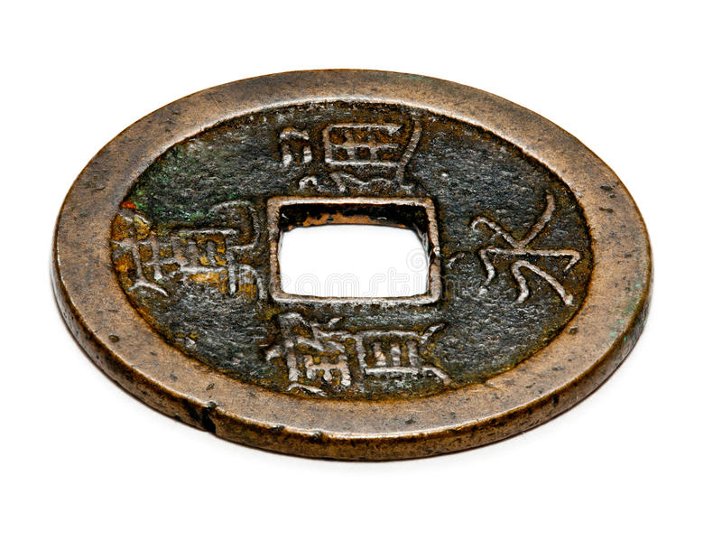 Antique chinese coin in macro. Macro image of an antique chinese coin with a square hole in the center isolated against white royalty free stock photography