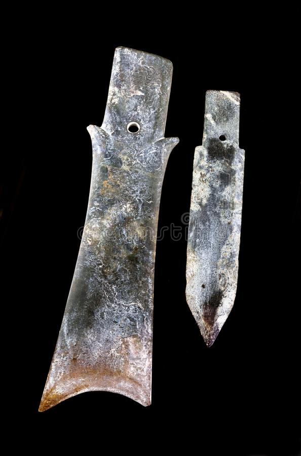 Antique Chinese Jade knives stock photography