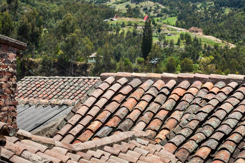 Antique clay roof tiles of the historical houses in the small town of Mongui in Colombia. An antique clay roof tiles of the historical houses in the small town royalty free stock image
