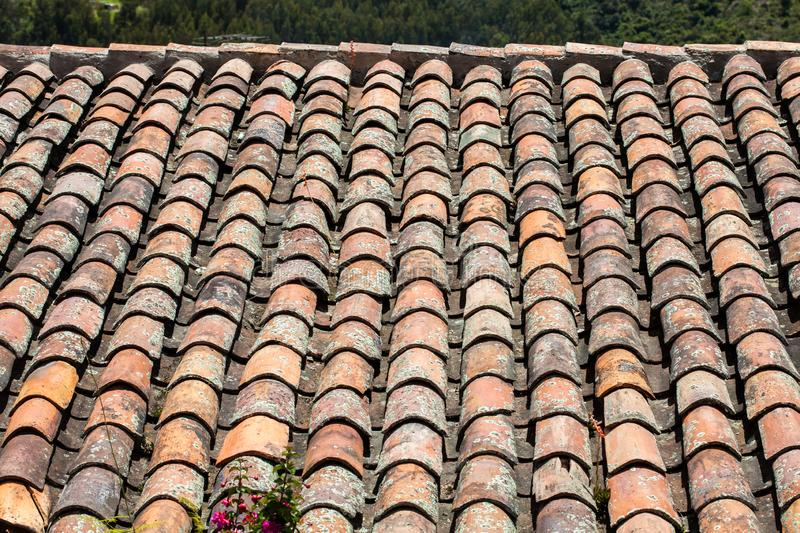 Antique clay roof tiles of the historical houses in the small town of Mongui in Colombia. An antique clay roof tiles of the historical houses in the small town stock photography