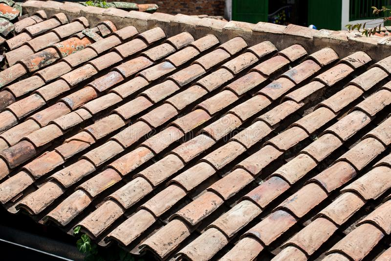 Antique clay roof tiles of the historical houses in the small town of Mongui in Colombia. An antique clay roof tiles of the historical houses in the small town royalty free stock photos