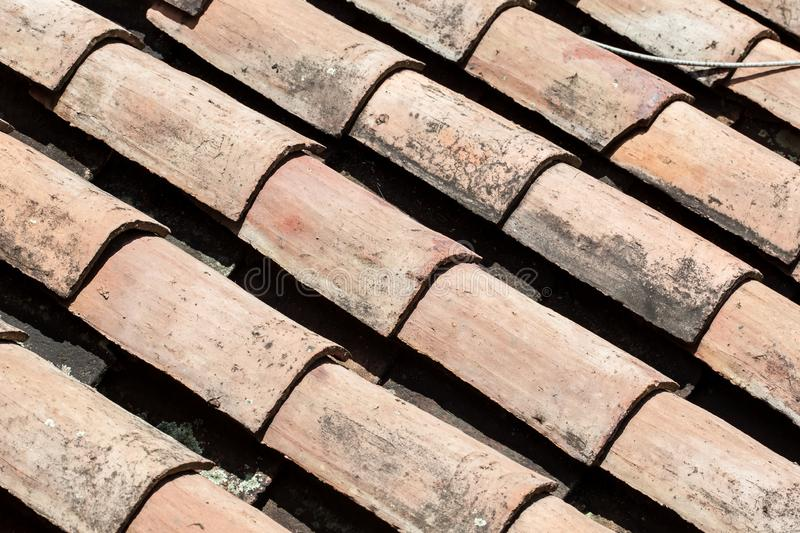 Antique clay roof tiles of the historical houses in the small town of Mongui in Colombia. An antique clay roof tiles of the historical houses in the small town royalty free stock photo