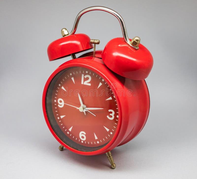 Antique clock and alarm clock. stock image