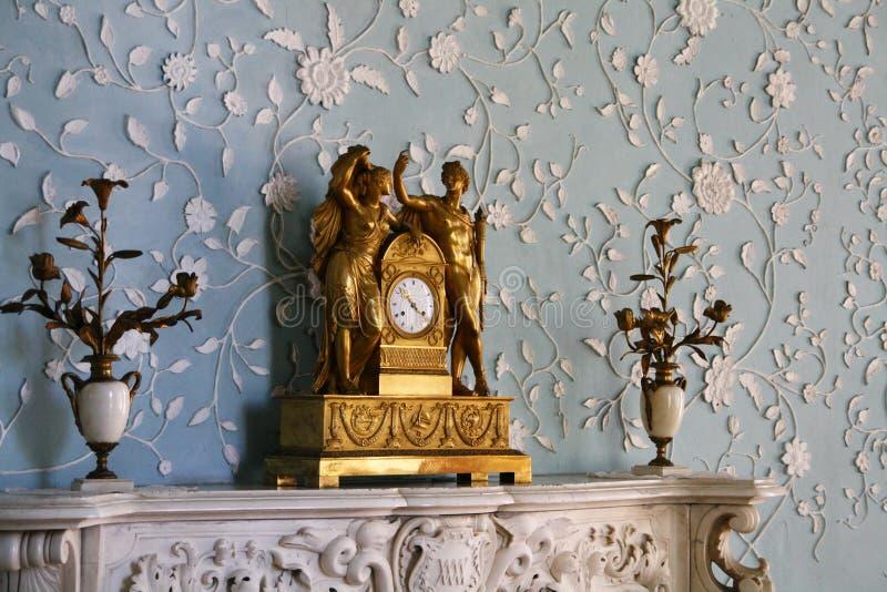 Antique clock. Antique bronze shelf clock with ornate decoration royalty free stock image