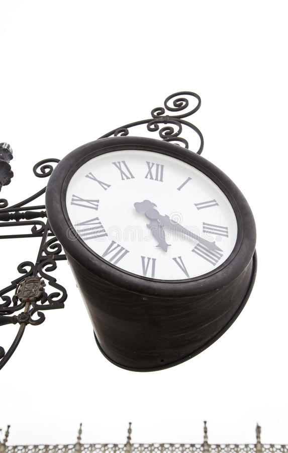 Antique clock in the city. Clock detail, urban decoration royalty free stock image