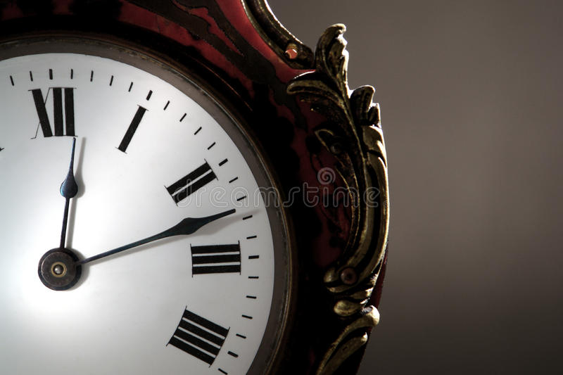 Antique Clock Face with Hands over Roman Numerals stock images