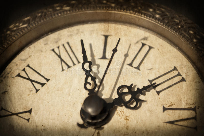 Antique clock on grunge background royalty free stock photo