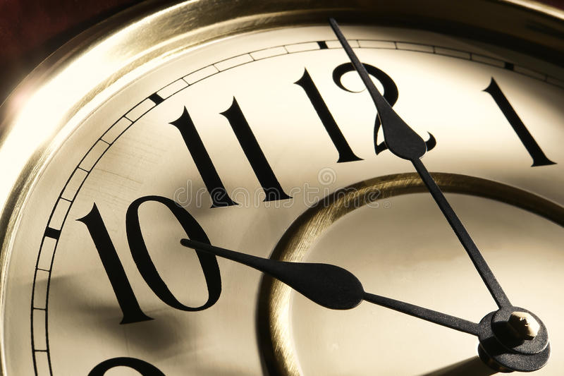 Antique Clock Hands with Time in Hours and Minutes stock image