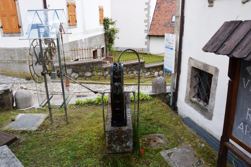 Antique clock mechanism in Pesariis city. An antique clock mechanism in Pesariis city, north Italy stock photo